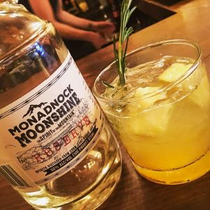 The Pineapple Sunshine- Pineapple-infused Monadnock Moonshine over ice with agave nectar, sour mix, garnished with rosemary and fresh pineapple.