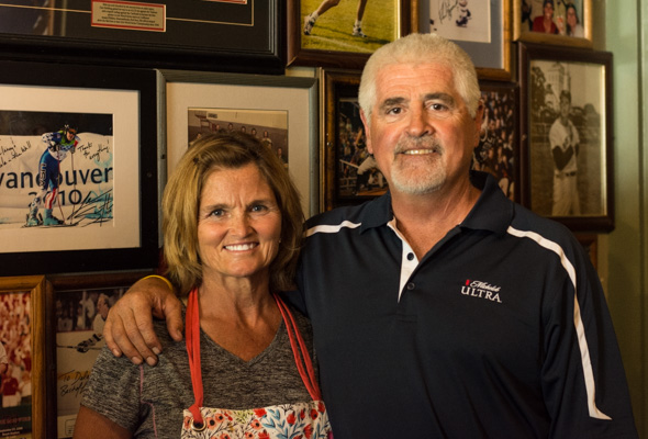 Owners Lanette and Dick Delaney, pictured in front of Delaney's massive collection of sports paraphernalia.