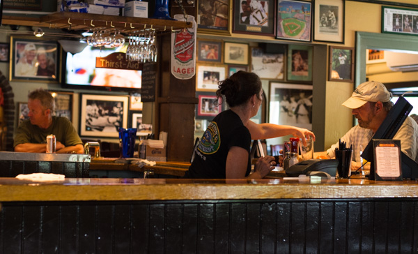 A bartender working hard through the lunch rush at Delaney's.
