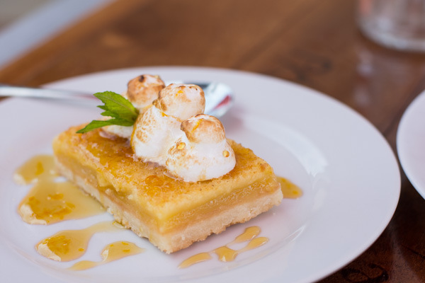 Lemon square topped with a brûléed meringue and honey produced on-site.