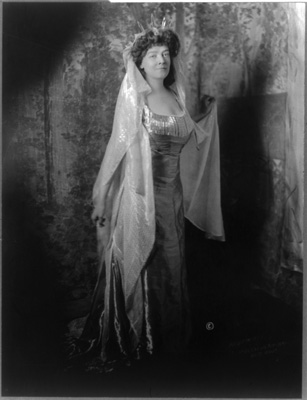 Mrs. Carolyn Foster Stickney, full-length portrait, standing, facing right, dressed as Lady Liberty for the Jekyll Island Club costume ball, January 16, 1911
