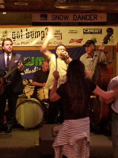 A live band performing at the Red Parka Pub.
