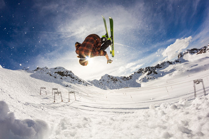 A skier defies gravity on a sunny winter day.