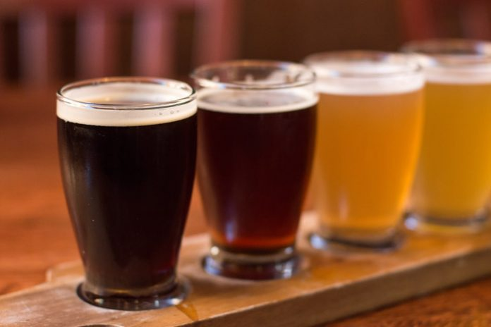 Enjoy a flight of craft beer at Manchester favorite Strange Brew Tavern