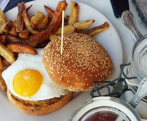 "The Hangover Burger at the Peddler's Daughter is made with everything you would need to cure your ""head cold""."