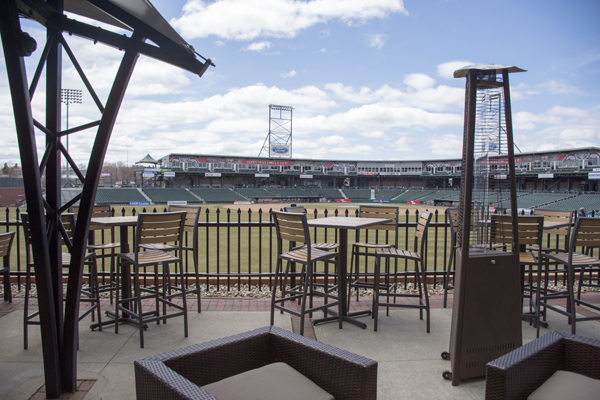 Hotel views and tables at The Patio overlook the Northeast Delta Dental Stadium.